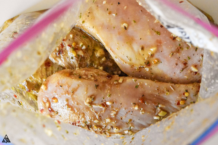 Marinating the chicken in a ziploc bag for a mediterranean chicken marinade